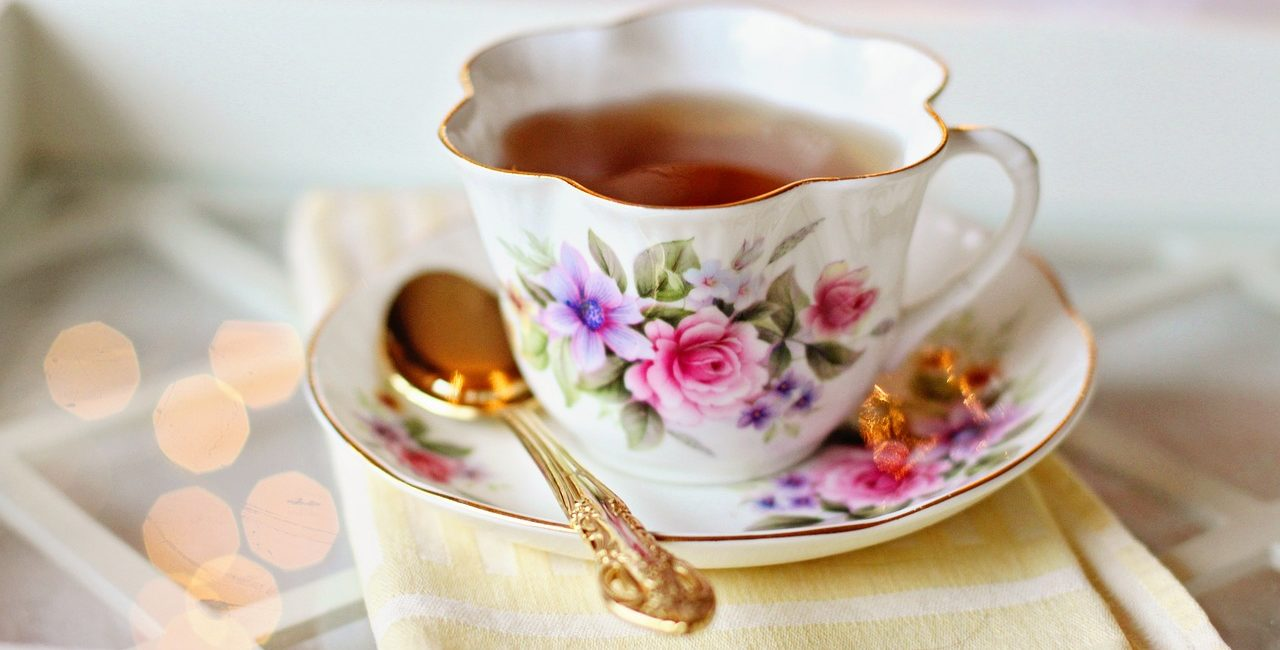 Flowery cup and saucer with gold spoon