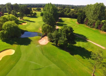 Aerial view of part of sand martins gold course showing greens, bunkers and trees