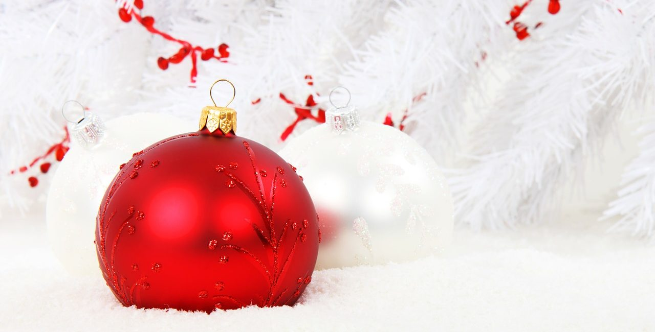 red shiny bauble on white background