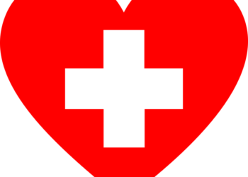 Red heart with grey and white cross cut out of the centre