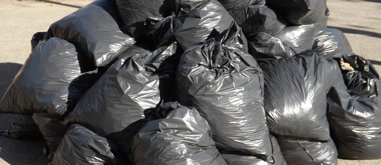 Heap of full black rubbish sacks
