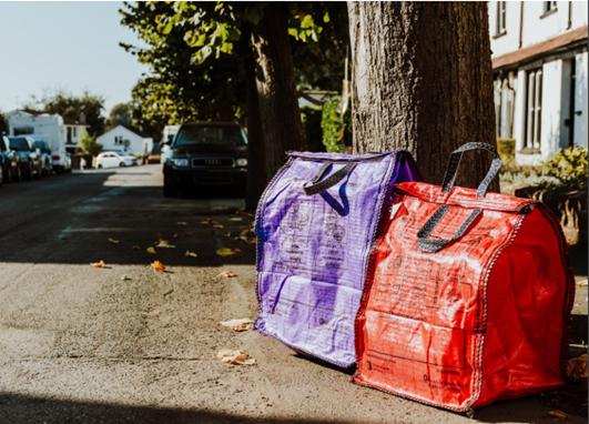 Purple and orange hessian recycling sacks