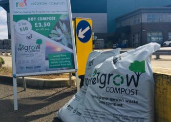 Bag of re3 compost with sign giving prices