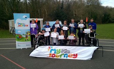 Lots of people with a my journey wokingham banner