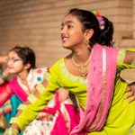 Young girls in colourful indian dress dancing