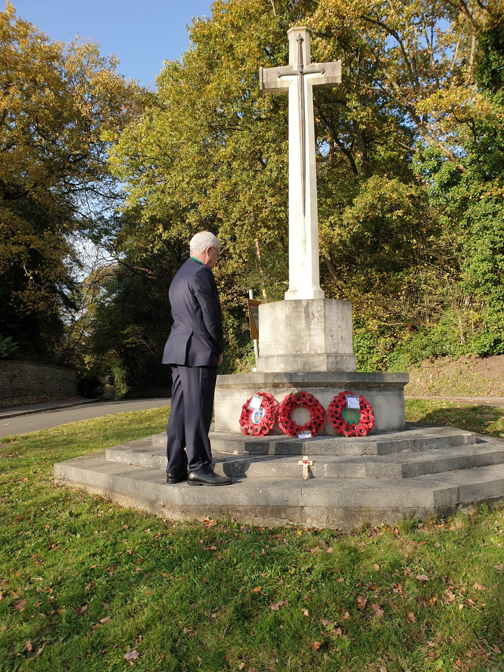 Cllr Simon Weeks laying wreath at War Memorial