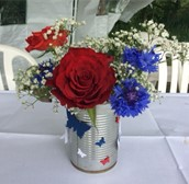 Silver can with red rose and blue cornflowers